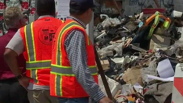 City Cleans Up Sprawling Trash Pile