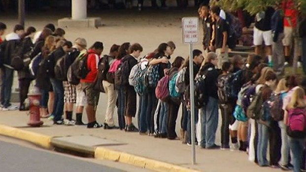 [DC] Classmates Hold Hands as They Mourn Herndon Family