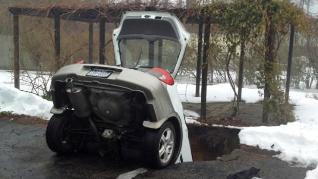 PHOTOS: Car Plunges Into Sinkhole