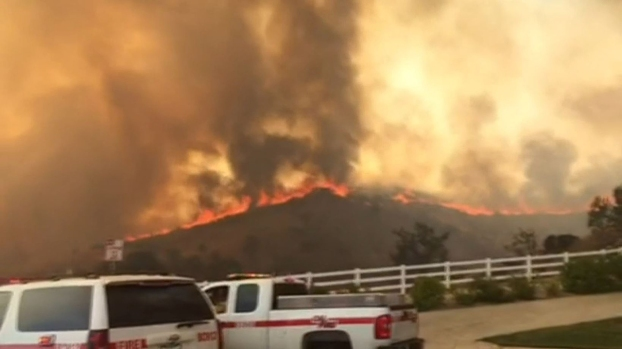 Photos: Mart Fire Near Highland Shuts Down Highway, Prompts Evacuations