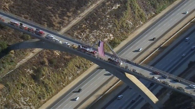 [la gallery] Mourners Line Southern California Freeway to Honor Firefighter Cory Iverson, Killed Fighting the Thomas Fire