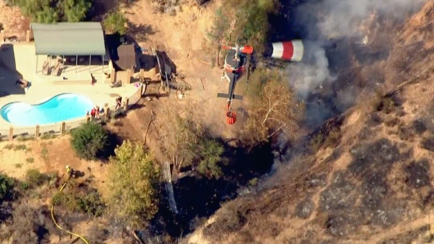 Crews Contain Wildfire Near Homes in Arrowhead Springs Area