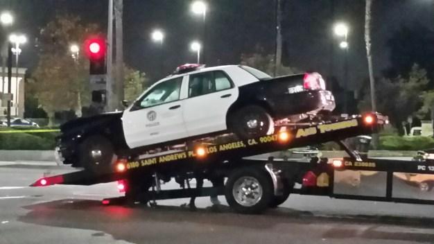 Officers, Pickup Driver Injured in Crash