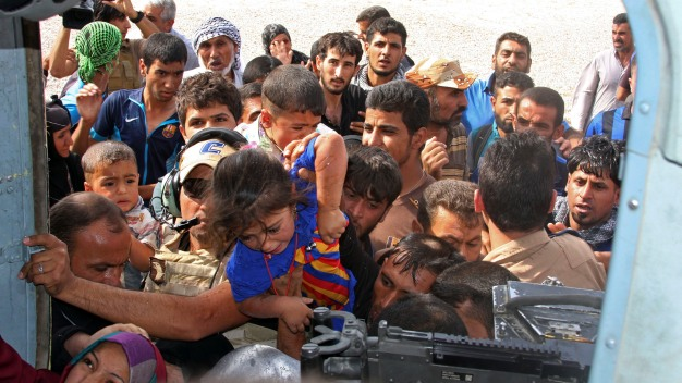 U.S. Strikes ISIS, Aids Besieged Iraqi City