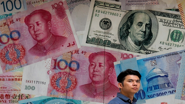 China Lets Currency Sink to 11-Year Low After Trump Threats