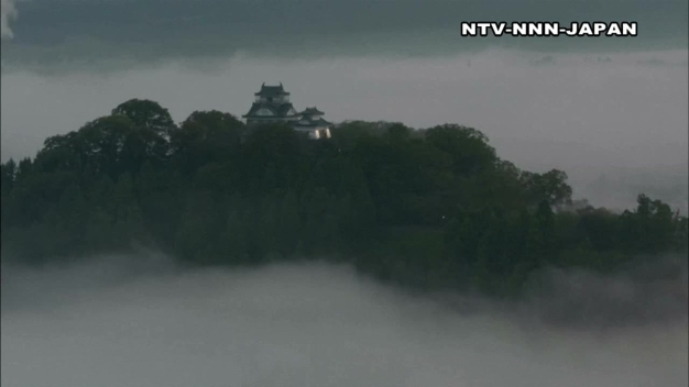 Stunning View of Castle Floating on Bed of Clouds