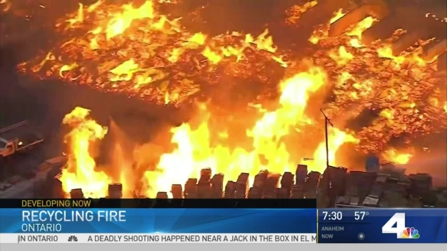 Firefighters Work to Contain Recycling Yard Inferno
