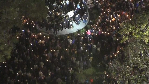 From the Sky: Hundreds Gather for Fallen Officer's Vigil