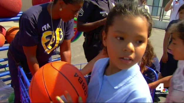 Teen's Team Brings Schools Needed Sports Equipment