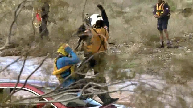 Video Shows Rescue of Men Stuck in Creek