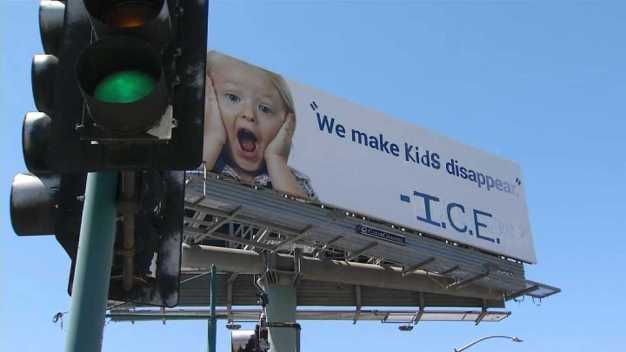 Activists Vandalize Billboard With Immigration Message