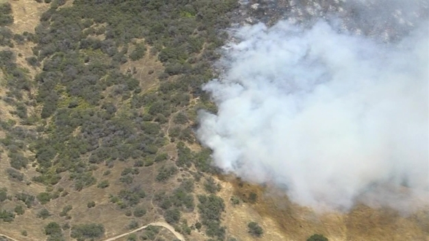 Firefighting Helicopters Drop Water on Brush Fire