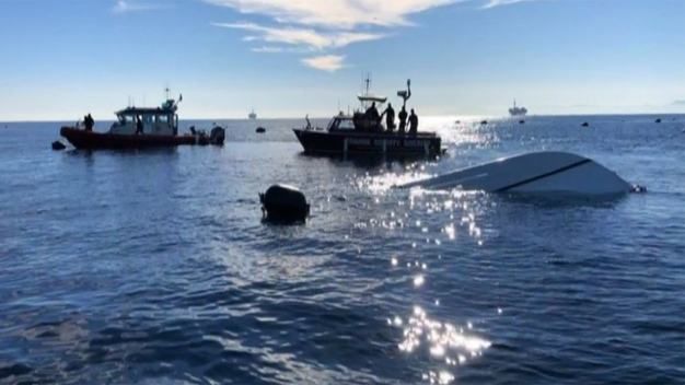 Officers, Lifeguards Help Find Two Men in a Capsized Boat