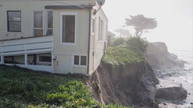 Waves, Erosion Batter Coast, Ranger's House Teeters on Cliff