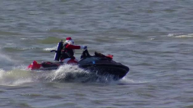 Santa and Elves Arrive By Jet Ski