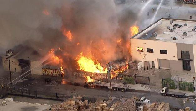 Downtown LA Fire Rages in Pallet Yard