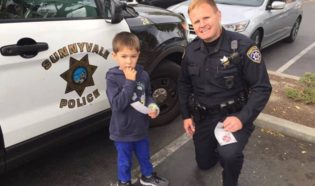 Police Officer Comforts Distressed Special Needs Boy