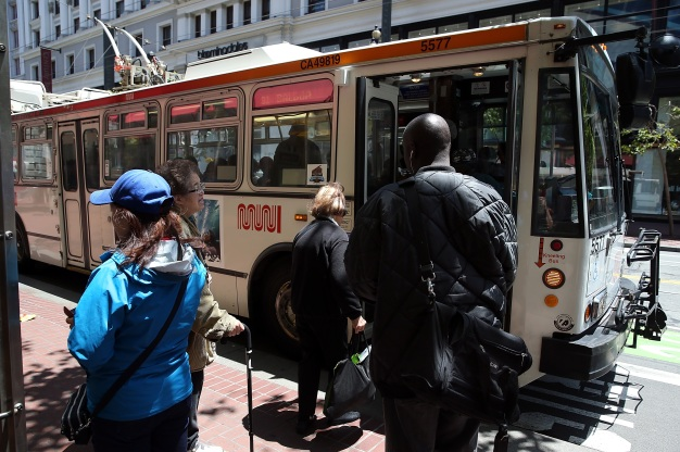 Man Sitting on San Francisco Bus Lights Woman's Hair on Fire