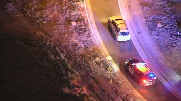 Pursuit Ends When Sheriff's Vehicles Surround Suspect's Car