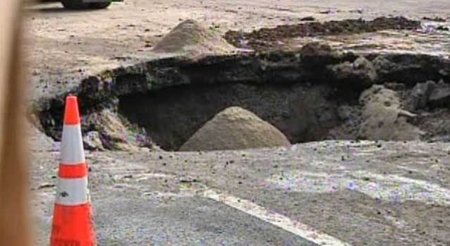 Water Main Rupture Leaves Massive Sinkhole In Van Nuys