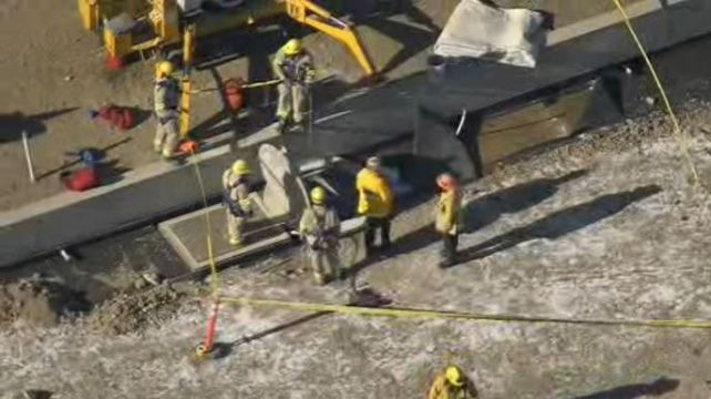 Crews Work to Pull Construction Worker Out of Well
