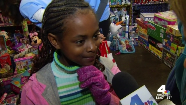 Hundreds of Children Get Toys and Meals at Midnight Mission