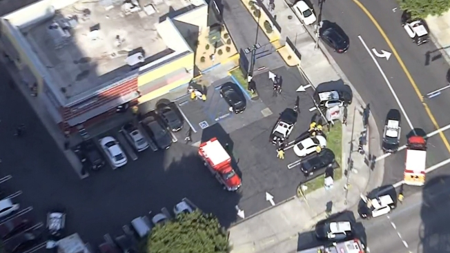1 killed, 3 injured in Hollywood stabbing, officer-involved shooting