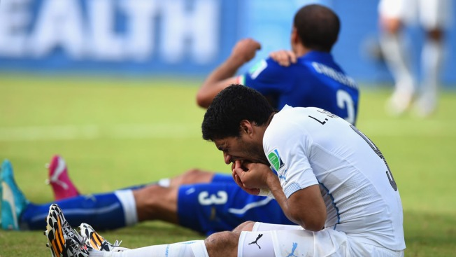 Game With Bite: Uruguay's Suarez Sinks His Teeth Into Italian World Cup Opponent