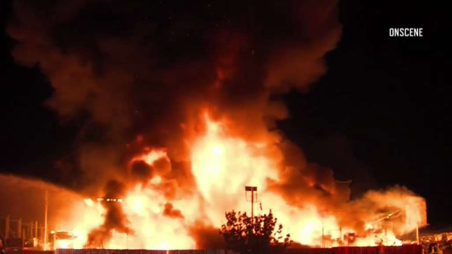 Explosive Fire at Auto Parts Yard Casts Bright Glow Over Sylmar