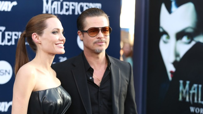 "Brad Pitt Breaks Silence on ""Maleficent"" Premiere Prankster: ""He's Going to Get Stomped"""