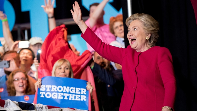 Clinton rallies with Michelle Obama as Trump alleges corruption