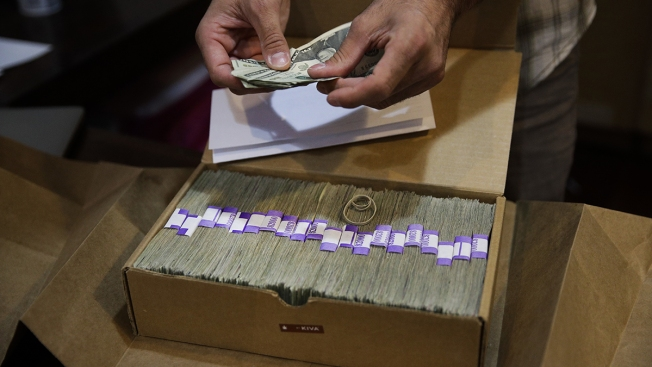 AP Exclusive: Inside the Scary Cash Dash of Paying Pot Taxes