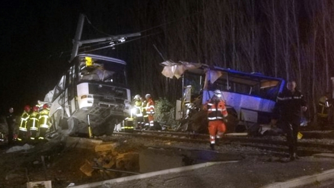 School bus, train crash in southern France