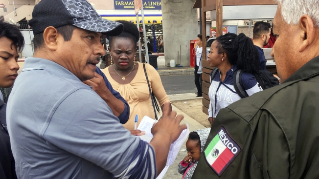 US Asylum Seekers Wait Their Turn on Mexican Border