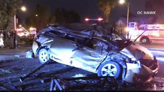 Driver Crashes Into Two Parked Cars Before Ending Up On Top Of Truck