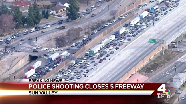 Freeway Shut Down After Murder Suspect Chase Ends In Shooting