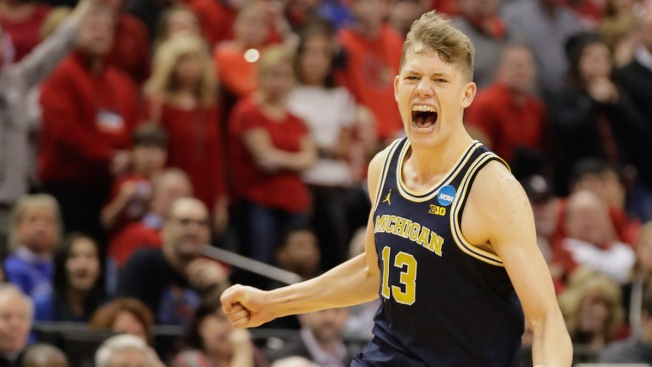 Wagner's big game sends Michigan past Louisville in NCAAs