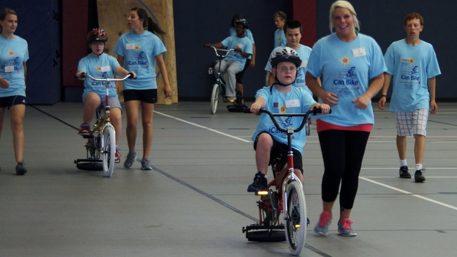 Camp Teaching Special-Needs Children to Ride Bicycle In Need of Volunteers