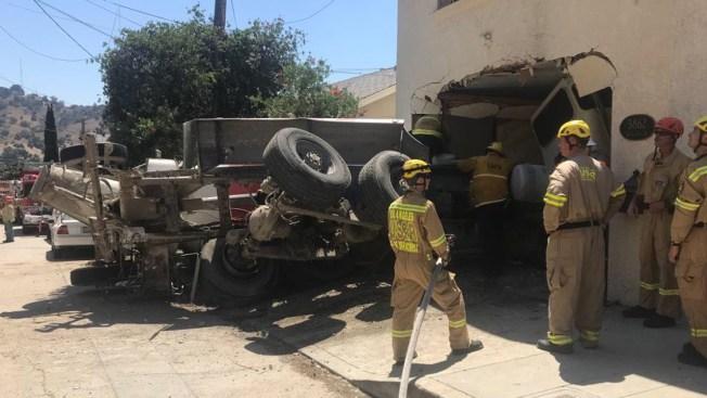 Cement Truck Rolls Downhill, Crashes Into Garage