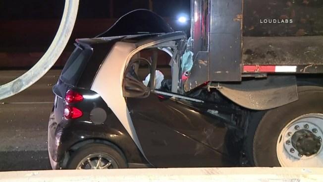 Smart Car Crashes Into Back Of Dump Truck