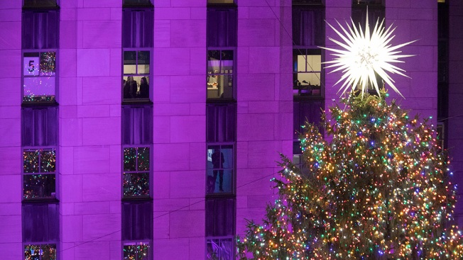 1st Look Presents Park City Getaway. Mary Altaffer/AP. People watch as the Rockefeller  Center Christmas tree ... - Sprucing Up In NYC: Rockefeller Center Lights Christmas Tree - NBC