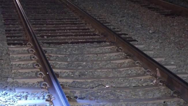 One Dead, 3 Injured in 3-Vehicle Crash That Lands on Metrolink Tracks