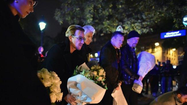 Irish Band U2 Lays Flowers Near Site of Attack in Paris