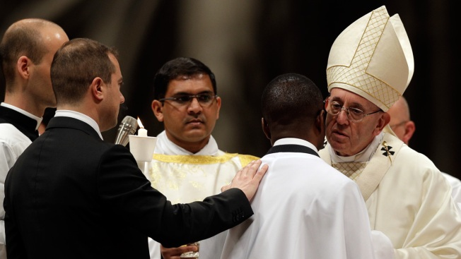 Pope in Easter Vigil Baptizes Nigerian Migrant-Hero