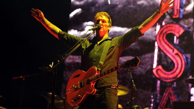 Queens of the Stone Age Singer Apologizes for Kicking Reporter at Concert