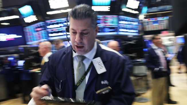 U.S.  stocks fall sharply on Trump woes; Dow -1.8%