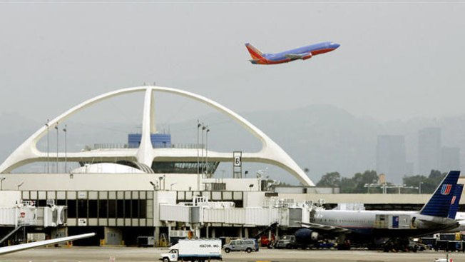 False Alarm Over LAX Gunman Sends Travelers Fleeing Onto Tarmac