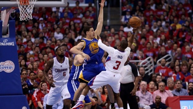 Paul Falls as Warriors Conquer Clippers in Game 1
