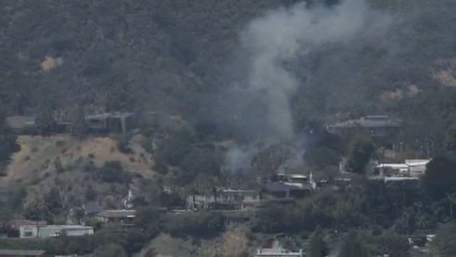 Brush Fire Burns Near Homes in Hollywood Hills