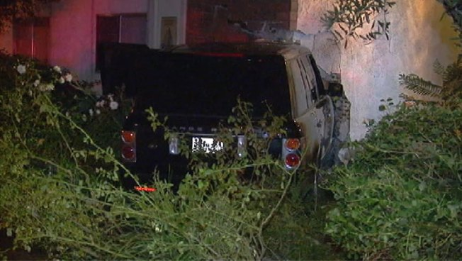 Range Rover Plows Into Man's Bathroom Wall